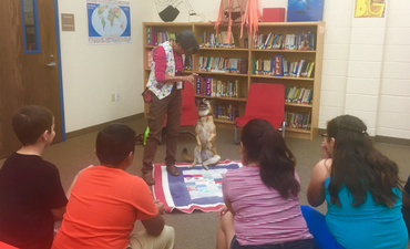 Image: therapy dog and her handler visit de Zavala students