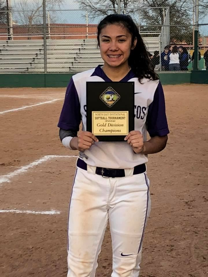 Kaylee Cavazos holds the Gold Division Championship Trophy from Last Year's Northeast Tournament